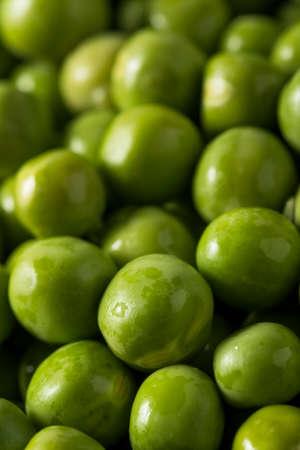 Raw Green Organic English Peas in a Bowl