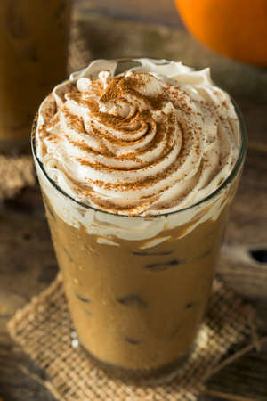 Sweet Iced Pumpkin Spice Latte with Whipped Cream Stock Photo
