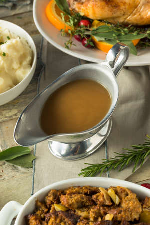 Hot Brown Organic Turkey Gravy in a Boat Stock Photo