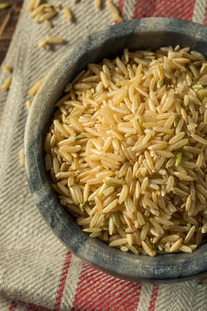 grained: Dry Organic Wild Long Brown Rice in a Bowl