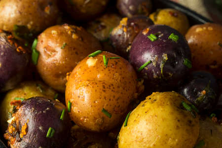 Savory Homemade Butter and Garlic Baby Potatoes with Chives Stock Photo