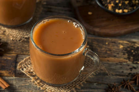 Organic Hot Chai Tea Drink with Milk and Spices Stock Photo