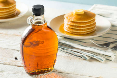 Raw Organic Amber Maple Syrup from Canada Stock Photo