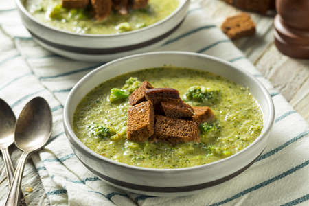 Homemade Organic Broccoli Soup with Rye Bread Croutons Stock Photo