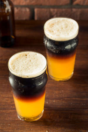 Irish Layered Black and Tan Beer with Lager and Stought Standard-Bild - 94428285