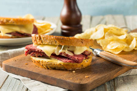 Savory Homemade Corned Beef Reuben Sandwich with Mustard and Cheese Stok Fotoğraf