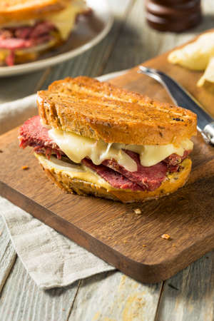 Savory Homemade Corned Beef Reuben Sandwich with Mustard and Cheese Stock Photo