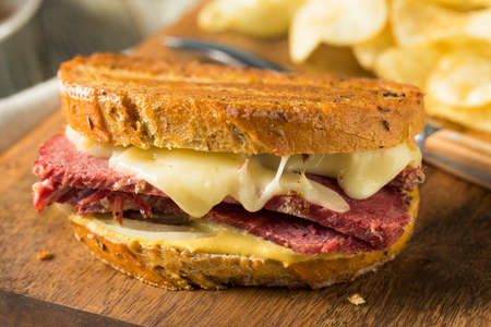 Savory Homemade Corned Beef Reuben Sandwich with Mustard and Cheese