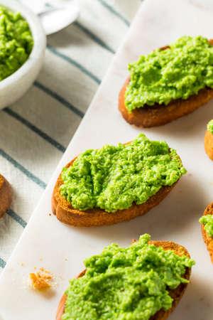 Sweet Homemade Pea Pesto Crostinis Ready to Eat Stock Photo