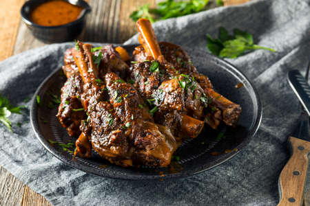Homemade Braised Lamb Shanks with Sauce and Herbs Stockfoto