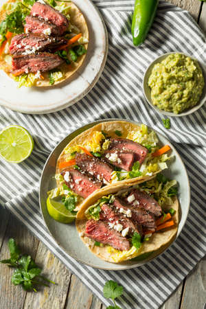 Homemade Korean Steak Tacos with Cabbage Cilantro and Cheese