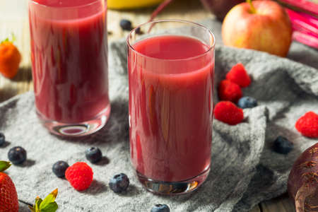 Raw Organic Red Berry Juice Smoothie in a Glass