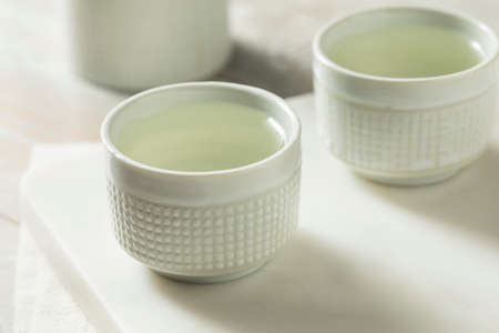 Alcoholic Japanese Sake Rice Wine in a Ceramic Glass Stock Photo