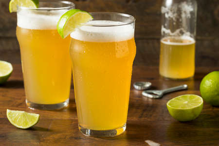 Alcoholic Refreshing Mexican Beer with Lime in a Pint Glass