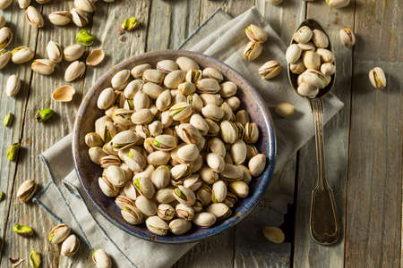 Raw Organic Green Fresh Pistachios in a Bowl