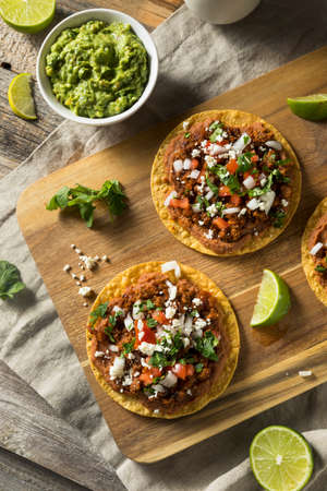 Homemade Beef and Cheese Tostadas with Lime and Cilantro Stock Photo