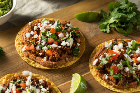 Homemade Beef and Cheese Tostadas with Lime and Cilantro Stock Photo - 97775007