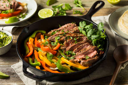 Homemade Beef Steak Fajitas with Peppers and Onions Stock Photo