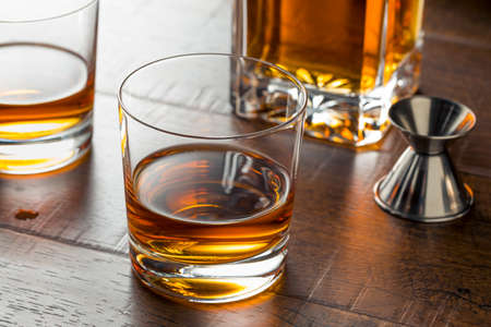 Delicious Bourbon Whiskey Neat in a Glass Stock Photo