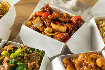Spicy Chinese Take Out Food with Chopsticks and Fortune Cookies 스톡 콘텐츠