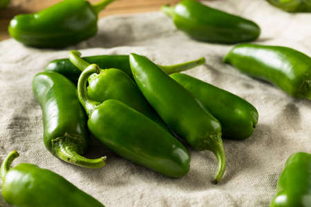 Raw green Organic Jalapeno Peppers Ready to Cook Stock Photo