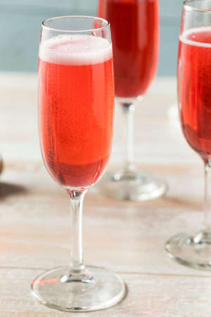 Sweet homemade Rose Mimosas with Berry Syrup