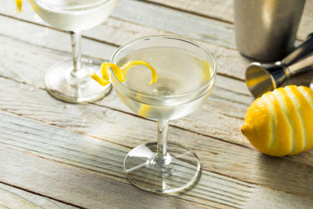 Homemade Alcoholic Vesper Martini with a Lemon Twist 写真素材