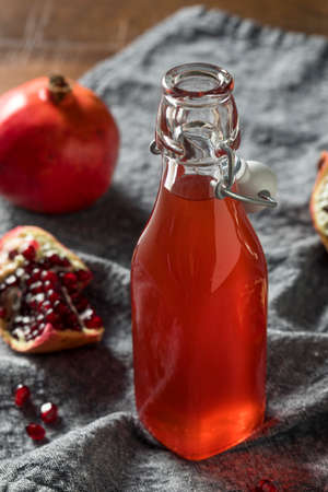 Homemade Sweet Red Pomegranate Grenadine Syrup in a Bottle