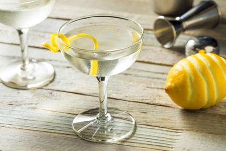 Homemade Alcoholic Vesper Martini with a Lemon Twist 免版税图像