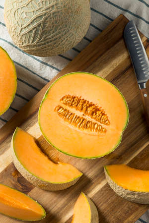 Raw Orange Organic Cantaloupe Cut into Slices Archivio Fotografico