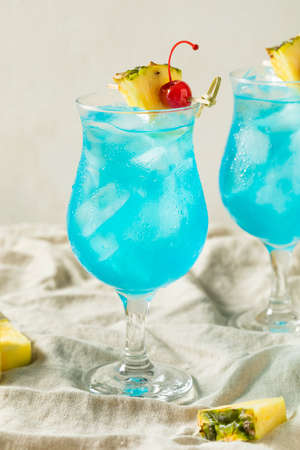 Boozy Blue Hawaii Hurricane Cocktail with Rum and Pineapple