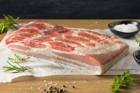 Raw Organic Pork Belly Meat with Salt and Pepper