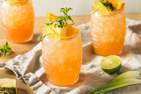 Refreshing Summer Tiki Cocktail Drink with Rum Lime and Pineapple Stock Photo