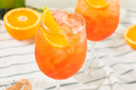 Alcoholic Aperol Spritz with Champagne and Oranges