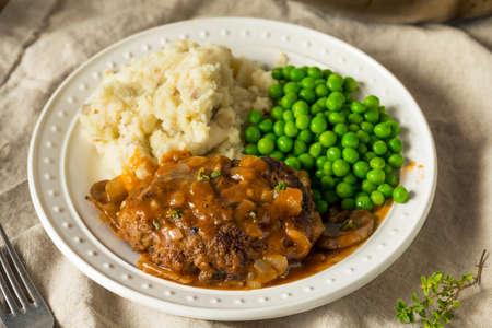 Homemade Savory Salisbury Steaks with Peas and Mashed Potatoes Stock Photo