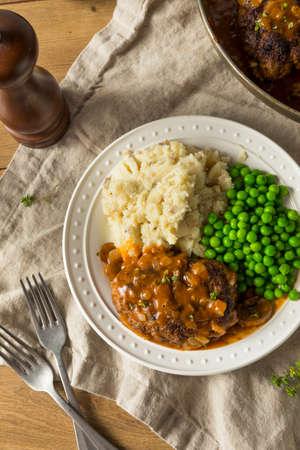 Homemade Savory Salisbury Steaks with Peas and Mashed Potatoes Banco de Imagens