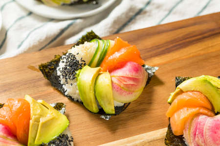 Homemade Trendy Japanese Sushi Donuts with Salmon Avocado and Veggies Reklamní fotografie
