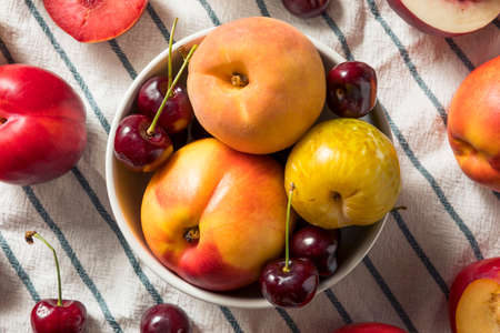 Raw Organic Assorted Stonefruit Peaches Plums and Nectarines Фото со стока