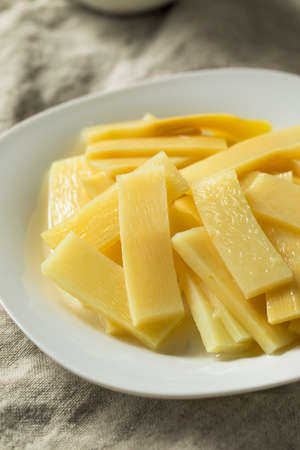 Raw Canned Bamboo Shoots on a Plate Foto de archivo