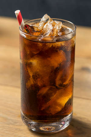 Bubbly Refreshing Dark Soda with Ice in a Glass Фото со стока