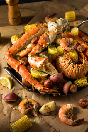 Homemade Cajun Seafood Boil with Lobster Crab and Shrimp Stock Photo