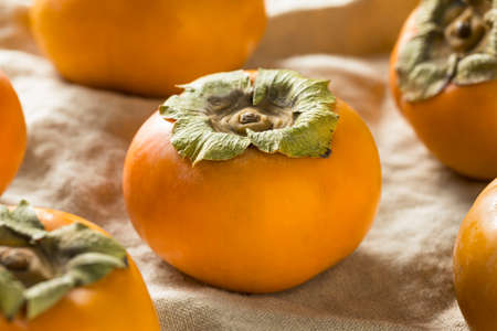 Raw Organic Orange Persimmon Fruit Ready to Eat 스톡 콘텐츠