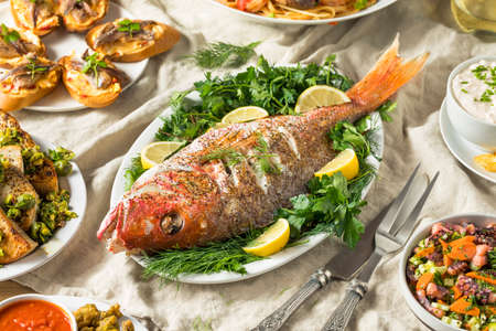 Holiday Italian Feast of 7 Fishes with Snapper Octopus and Pasta Foto de archivo