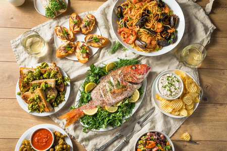 Holiday Italian Feast of 7 Fishes with Snapper Octopus and Pasta Stok Fotoğraf
