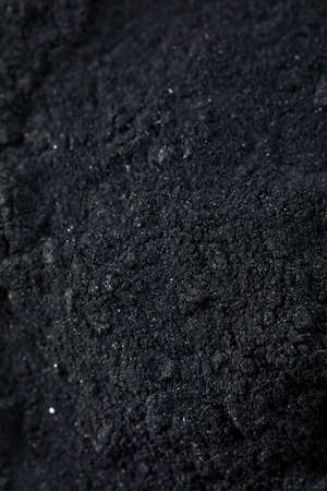 Raw Organic Black Activated Charcoal in a Bowl Stock Photo