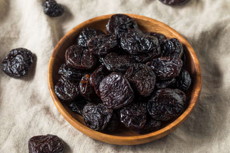 Raw Organic Dry  Prunes in a Bowl