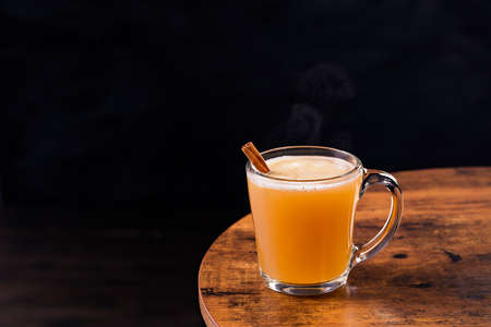 Warm Whiskey Hot Buttered Rum on a Table