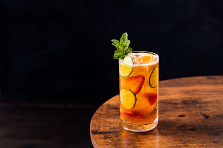 Refreshing Pimms Cup Cocktail on a Table