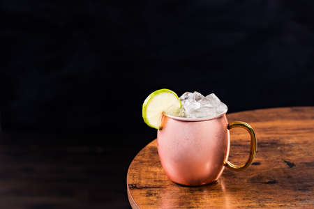 Refreshing Vodka Moscow Mule Cocktail on a Table