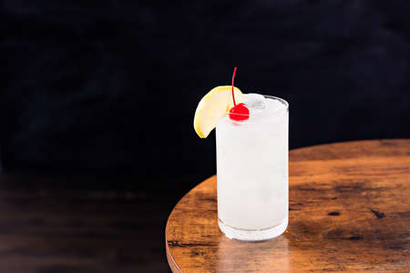Refreshing Tom Collins Cocktail on a Table